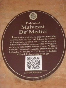 A QR code on a Medici plaque