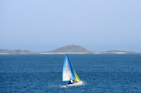 A photo of a small sailing boat sailing off the Scilly Isles